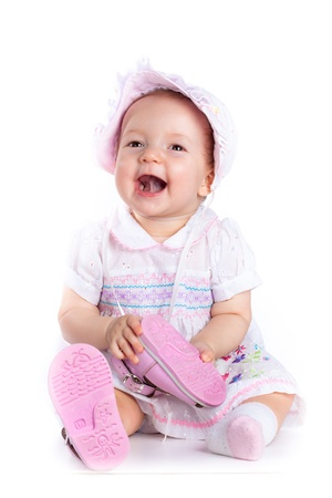 Baby in studio against a white background. Stock Photo