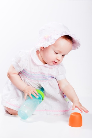 Baby in studio against a white background. Stock Photo - 8462623
