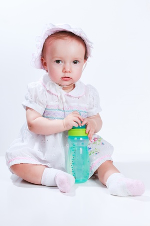 Baby in studio against a white background. Stock Photo - 8462621