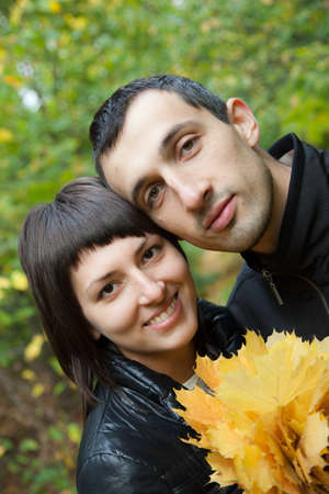 aureate: Young beautiful pair in the autumn on the nature.