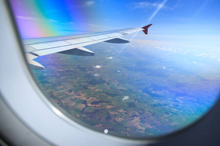 airplane window: View from the window of an airplane. Stock Photo