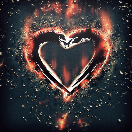 heart in flame: Heart with splinters Stock Photo
