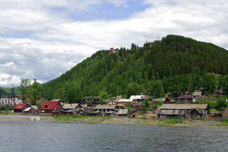 inflow: Makarak - taiga village on the river Kiya Stock Photo