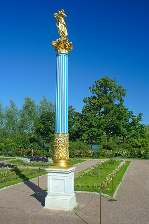 olgas: Crystal column with a statue in the garden on the Czarinas island in Peterhof
