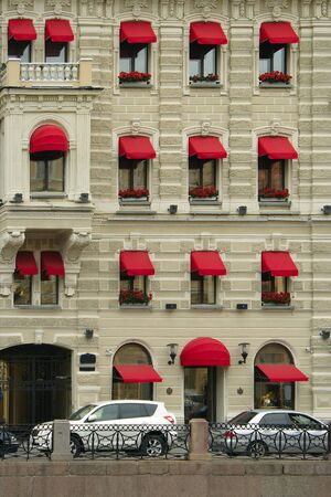 awnings: St. Petersburg, house with red awnings on the Moika river embankment Editorial