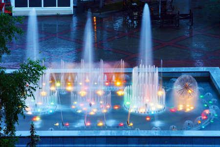 colourful lightings: Krasnoyarsk, the fountain at the Theater Square in the rain at dusk