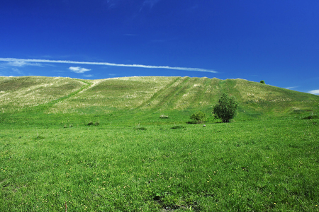 green hills: Green hills and blue sky in the early summer Stock Photo