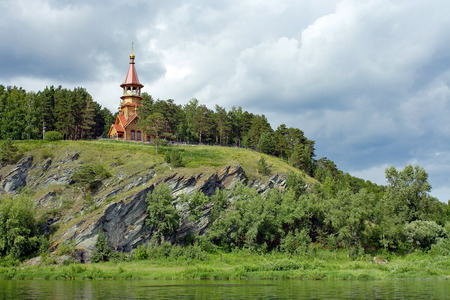mount tom: Chapel on the high rocky shore of the Siberian river Tom
