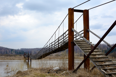 novosibirsk: Suspended pedestrian bridge over the river Berd, in the village of Peteni, Novosibirsk region