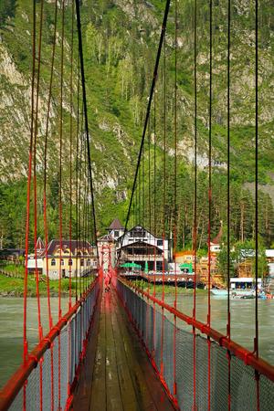 katun: Tourist base in the Altai mountains, the view from the pedestrian bridge over the Katun river
