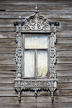 wood carvings: Tomsk, old wooden house window decorated with wood carvings Stock Photo