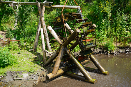 water wheel: Decorative water wheel in the garden