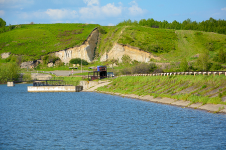 The dam of the Barachat reservoir on the river Northern Unga, Kemerovo region Stock Photo
