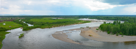 Panoramic views of the river Kiya from the top Shestakovsky Yar. Here is located the largest Russian cemetery of dinosaurs