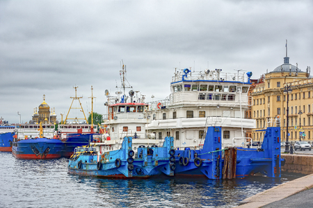 St. Petersburg, the ships pushers tugs on the pier on the waterfront Lieutenant Schmidt