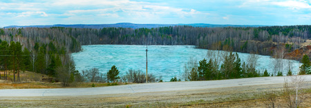 The lake on the site of the former quarry for the extraction of refractories near the village of Aprelka, Kemerovo region Stock Photo
