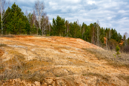 Exit of a layer of red refractory clay near the village Aprelka, Kemerovo region, Western Siberia