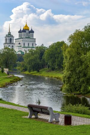Pskov, view of Trinity Cathedral from Park Kuopio on  banks of  river Pskova, summer rain