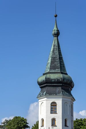 Vyborg, a fragment of the old town hall Tower, against a cloudless sky Imagens