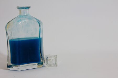 colored bottle: Colored Bottle with different colors, liquid Stock Photo