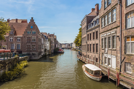 Travel Belgium medieval european city town background with canal  Ghent, Belgium photo