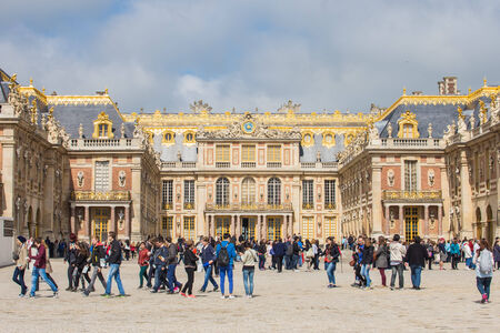 louis the rich heritage: VERSAILLES, FRANCE - MAY 14, 2014: Every day many tourists wish to visit Versailles Palace. The Palace Versailles was a royal chateau. It was added to the UNESCO list of World Heritage Sites.