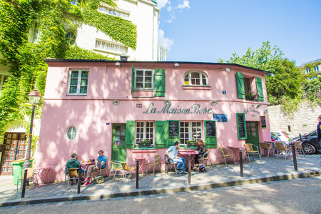 PARIS - May 14: View of typical paris cafe on May 14, 2014 in Paris. Montmartre area is among most popular destinations in Paris, La Maison Rose is a typical cafe.