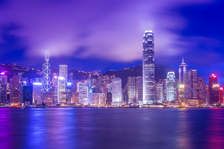 Hong Kong Victoria Harbour cityscape at night. Stock Photo