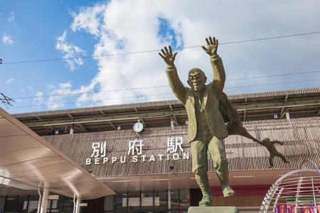 Statue of Kumahachi Aburaya or the shiny uncle at Beppu train station in Oita, Japan.