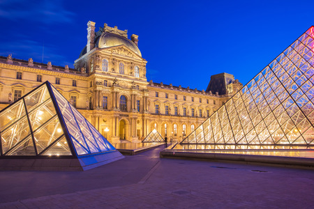 louvre pyramid: Paris, France - May 13, 2014: The Louvre Museum is one of the world Editorial