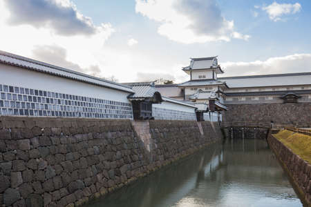 moat wall: Kanazawa, Japan - February 15, 2015: Kanazawa castle in Kanazawa, Japan is a large, well-restored castle in Kanazawa, Ishikawa Prefecture, Japan. It is located adjacent to the celebrated Kenroku-en Garden, which once formed the castle