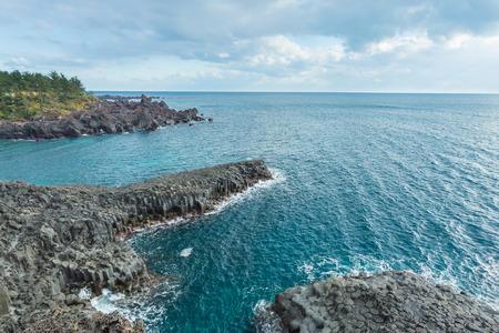 columnar: Jungmun Daepo coast with columnar joints at Jeju Island, South Korea.