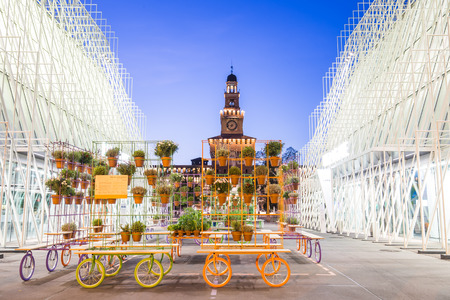 sforza: Milan, Italy - April 14, 2015: Expo 2015 Gate in Piazza Castello, Milan, Italy with the Sforza Castle in background on April 14, 2015. Expo 2015 is the next Universal Exposition.
