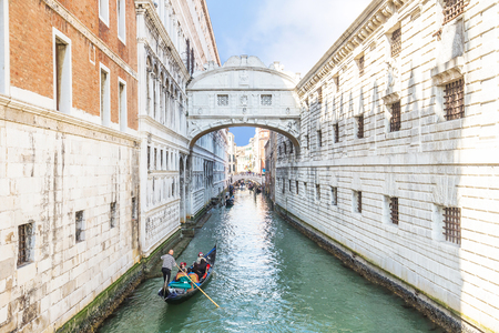 passing over: Gondolas is passing over Bridge of Sighs in Venice, Italy.