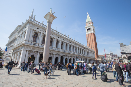 doge: Venice, Italy -  April 12, 2015: The crowd of people in Piazza San Marco with Campanile, Basilika San Marco and Doge Palace. Venice, Italy.