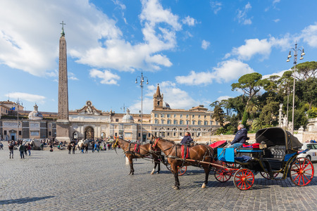 literally: Rome Italy  April 7 2015: Piazza del Popolo is a large urban square in Rome. The name in modern Italian literally means peoples square.