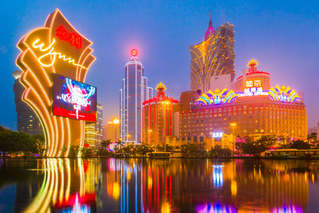 Macau, China - January 26, 2013: The buildings of casino in Macau with Light Performance Show in Dusk.