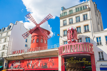 rouge: Paris, France - May 14, 2014: Moulin Rouge is a cabaret in Paris, France.