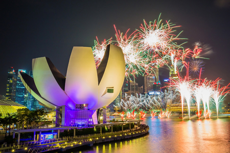 singapore: Singapore Skyline and view of Marina Bay with 50 years of independence fireworks.