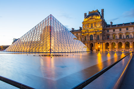 louvre pyramid: Paris, France - May 13, 2014: The Louvre Museum is one of the worlds largest museums and a historic monument. A central landmark of Paris, France. Editorial