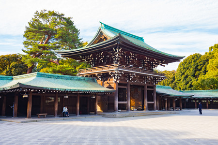 Tokyo: Tokyo, Japan - February 16, 2015: Meiji Shrine located in Shibuya, Tokyo, is the Shinto shrine that is dedicated to the deified spirits of Emperor Meiji and his wife, Empress Shoken.