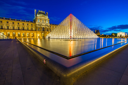 Paris, France - May 13, 2014: The Louvre Museum is one of the worlds largest museums and a historic monument. A central landmark of Paris, France. Editorial