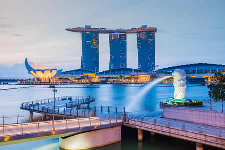 singapore city: Singapore City, Singapore - July 18, 2015: Marina Bay skyline and Merlion in the morning. The Marina Bay is a bay near Central Area in of Singapore, and lies to the east of the Downtown Core. Editorial