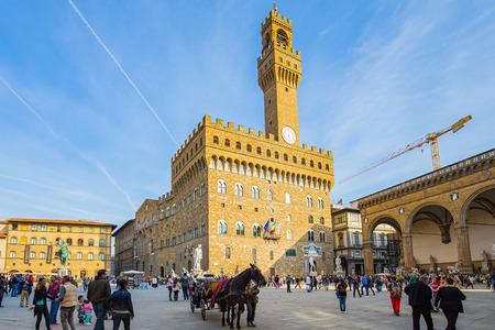 signoria square: Florence, Italy - April 10, 2015: Piazza della Signoria is an L-shaped square in front of the Palazzo Vecchio in Florence, Italy.