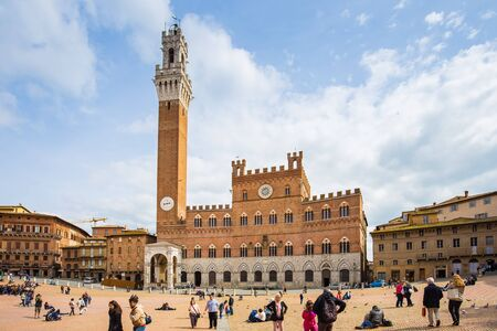 siena italy: Siena, Italy - April 11, 2015: The Campo Square with Mangia Tower the landmark of Siena, Italy.