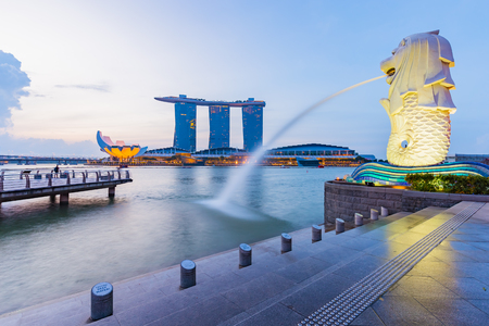 singapore: Singapore City, Singapore - July 18, 2015: Marina Bay skyline and Merlion in the morning. The Marina Bay is a bay near Central Area in of Singapore, and lies to the east of the Downtown Core. Editorial
