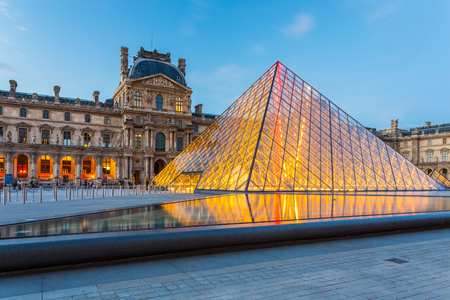 the museum: Paris, France - May 13, 2014: The Louvre Museum is one of the worlds largest museums and a historic monument. A central landmark of Paris, France. Editorial