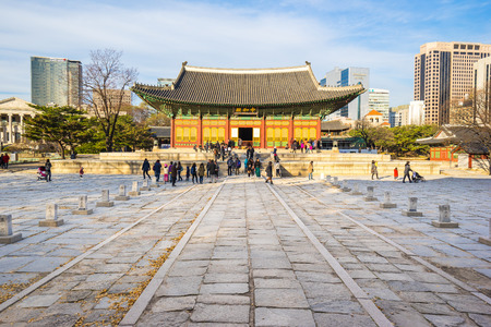 gung: Seoul, South Korea - December 6, 2015: Deoksugung Palace is a walled compound of palaces in Seoul that was inhabited by various Korean royalties until the colonial period around the turn of the 20th century. Editorial