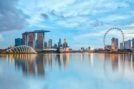 Singapore City, Singapore - July 17, 2015: Marina Bay is a bay near Central Area in the southern part of Singapore, and lies to the east of the Downtown Core. The area surrounding the bay itself, also called Marina Bay Stock Photo