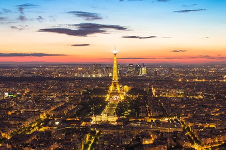 may: Paris, France - May 14, 2014: Light up at Eiffel tower with the Paris city skyline at night